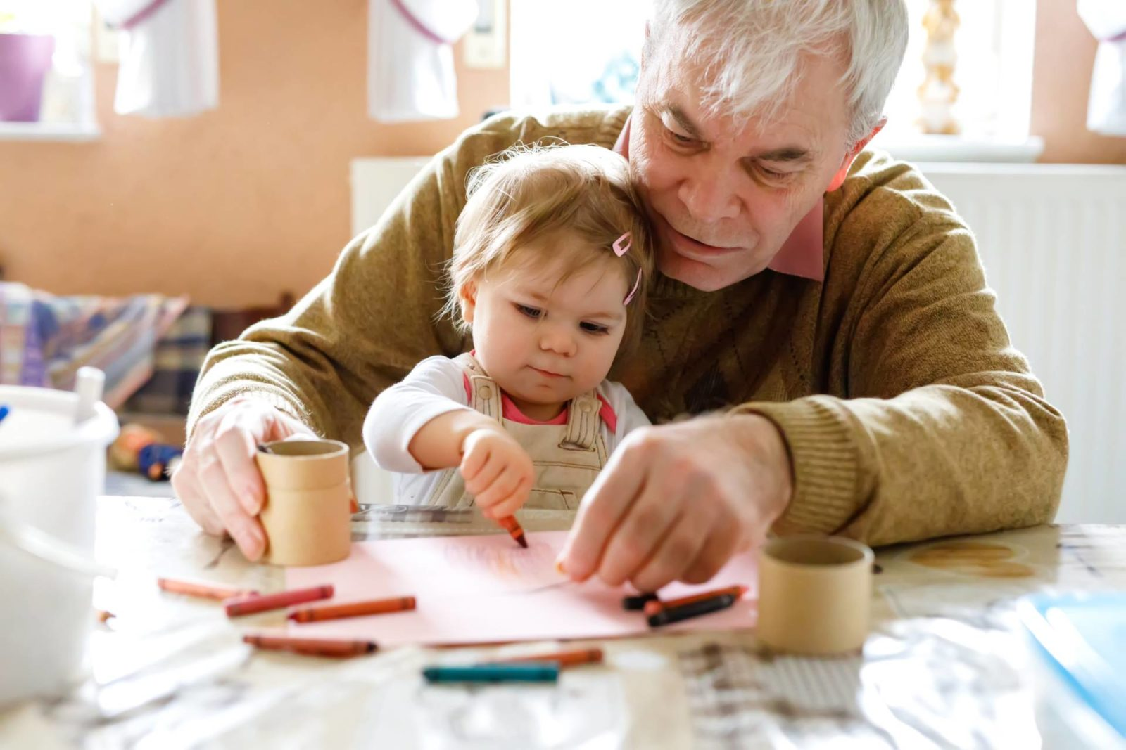 Man drawing with child